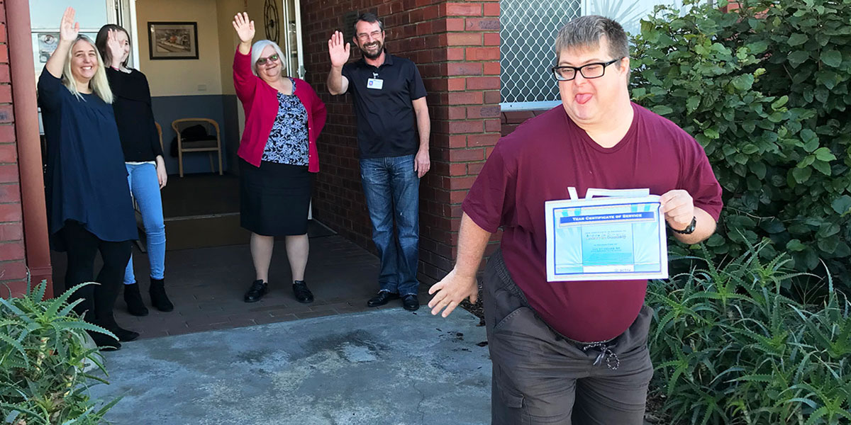 Andrew leaving Osborne Park Business Services as staff wave him goodbye.
